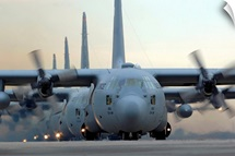 C130 Hercules aircraft taxi out for a mission during a sixship sortie