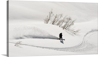 A Backcountry Snowboarder Carving In Turnagain Pass, Alaska