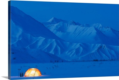 A Backpacking Tent Lit Up At Twilight Alaska Range In The Distance