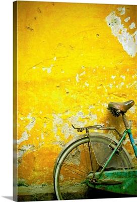 A Bike Leaning Against A Wall; Hanoi, Vietnam