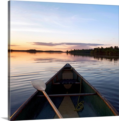 A Boat And Paddle On A Tranquil Lake At Sunset, Ontario, Canada