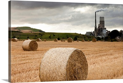 A Cement Production Plant With Hay Bales In A Field In The Foreground; Lothian Scotland