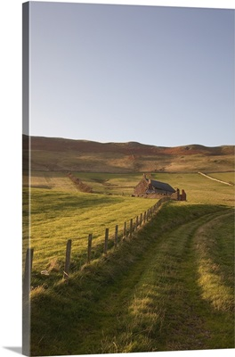 A Farm Structure And A Fence Around A Field, Northumberland, England