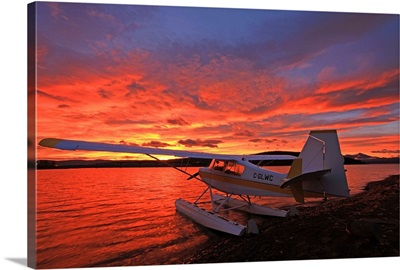 A Float Plane Facing The Sunrise Over Teslin Lake, Yukon, Canada