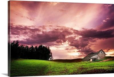 A Lonely Farm Building In An Open Field