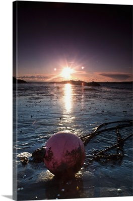 A Rope Tied To A Buoy Laying In The Tide On The Shore at Sunset, Dumfries, Scotland