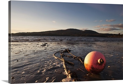 A Rope Tied To A Buoy Laying In The Tide On The Shore, Dumfries, Scotland