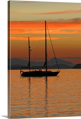 A sailboat is anchored for the night in the Gulf Islands of British Columbia