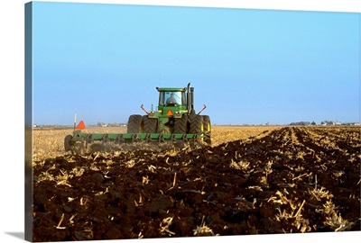 A tractor and field implement preparing the field for overwintering