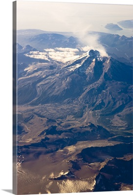 Aerial view of Mount Redoubt with steam coming out of the crater