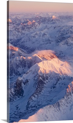 Aerial view of the Chugach Mountain range with sunrise alpenglow hitting the peaks