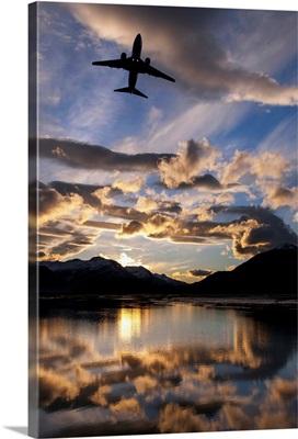 Alaska Airlines jet takes off from Juneau International airport at dawn, Juneau, Alaska