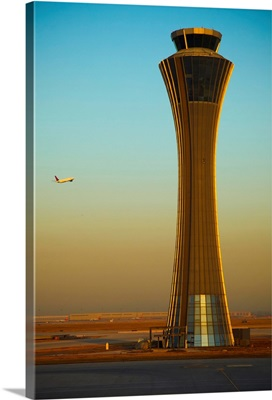 An Airplane Flies Past The Air Traffic Control Tower At The Beijing Airport, China