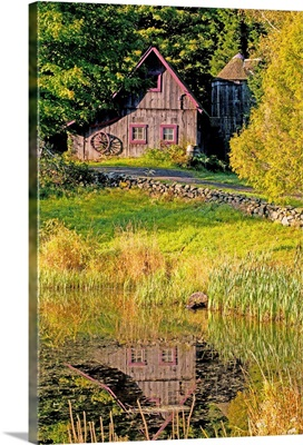 An Old Barn Reflected In Pond; Ville De Lac Brome, Quebec, Canada