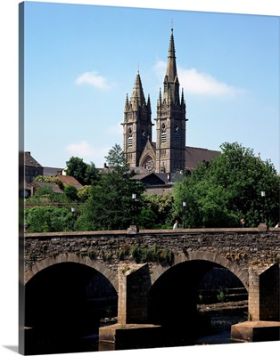 Arch Bridge Across A River With A Church In The Background, Omagh, Northern Ireland