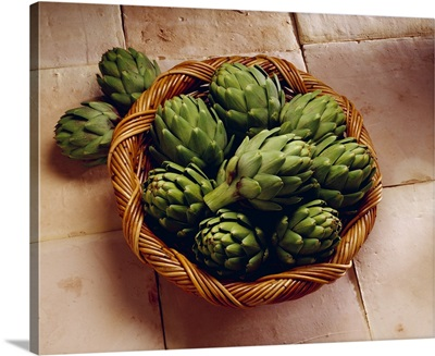 Basket of artichokes on tile