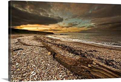 Beach at sunset with dark dramatic clouds, Tyne and Wear, England