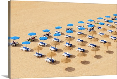 Beach Chairs And Umbrellas Set Up In Row On The Beach; Albufeira Algarve Portugal