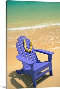 Blue Beach Chair With Plumeria Lei Hanging On Side Wall