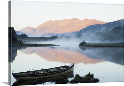 Boat On A Tranquil Lake; Killarney National Park, Killarney, County Kerry, Ireland