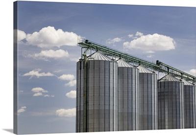 Calgary, Alberta, Canada; A Row Of Large Grain Bins