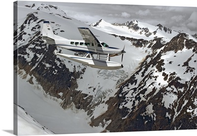 Cessna Caravan Amphibian Seaplane Flying Through Coast Mountains, British Columbia