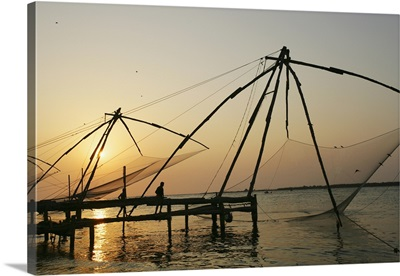 Chinese Fishing Nets Hanging In The Water At Sunset, Fort Kochi