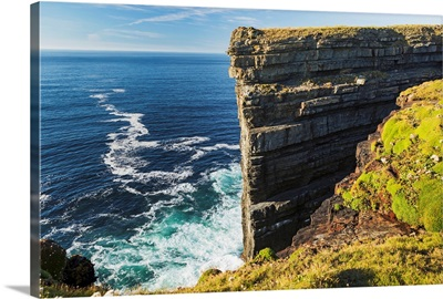 Cliff face rock formation in ocean with waves, Kilkee, County Clare, Ireland