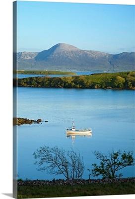Co Mayo, Ireland; Fishing Boat In Clew Bay Beneath Croagh Patrick