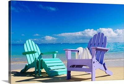 Colorful Beach Chairs On Beach, Calm Waves Washing Ashore