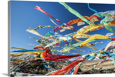 Colourful Tibetan prayer flags under the strong wind, Qinghai province, Tibet