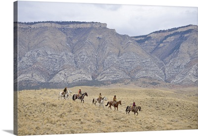 Cowboys And Cowgirls Riding Horse In Wilderness, Rocky Mountain, Wyoming