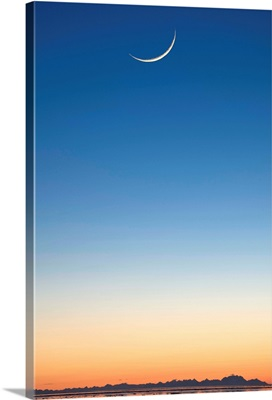 Cresent Moon Rising At Sunset Over Cook Inlet, Anchorage, Southcentral Alaska