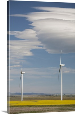 Dramatic Clouds With Blue Sky And Windmills; Alberta, Canada