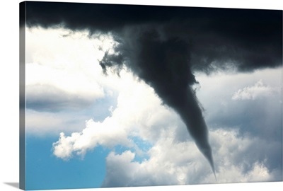 Dramatic funnel cloud created in dark storm clouds, Calgary, Alberta, Canada