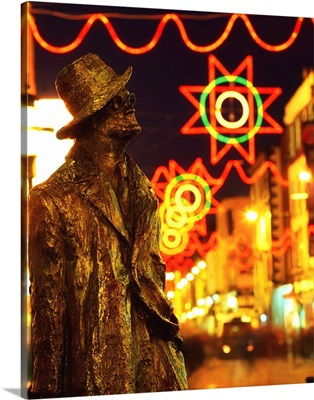 Dublin, Ireland; Sculpture Of James Joyce With Christmas Decorations In Background