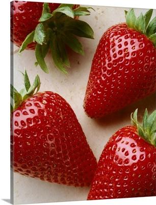 Extreme closeup of ripe strawberries