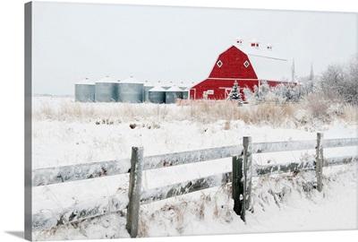 Farm Yard With A Red Barn And Metal Grain Bins In Winter, Alberta, Canada