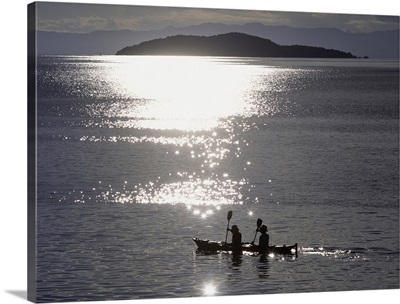 Fishermen Going Past The Island Of Domwe At Dusk; Malawi, Africa