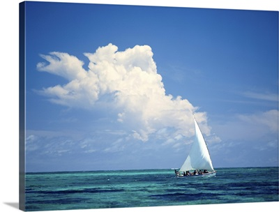 Fishermen In Dhow Sailing In Shallow Water In Front Of Large Thunder Storm Cloud