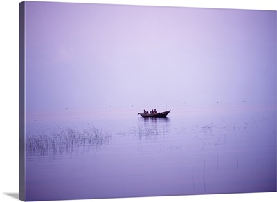 Fishermen In Their Boat Shortly Before Dawn On Lake Chilka; India