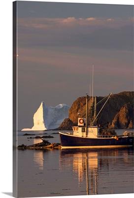 Fishing Boat Near An Iceberg, Newfoundland And Labrador, Canada