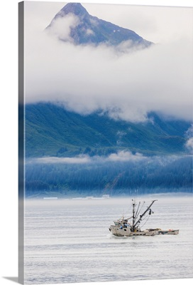 Fishing boat outside of Valdez with misty clouds, Prince William Sound, Alaska