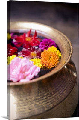 Flowers Floating In A Bowl Filled With Water; Bhaktapur, Nepal