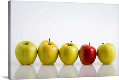 Four Yellow Apples With One Red Apple In A Row