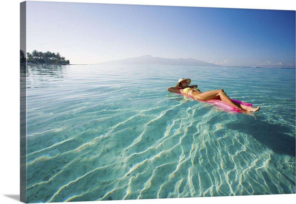 French Polynesia Tahiti Moorea Woman Floating In Water
