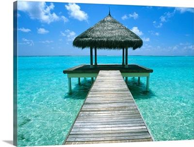 Grass Hut And Pier; The Maldives