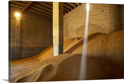 Harvested rice in a storehouse waiting to be transported