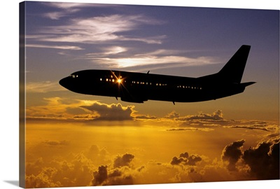 Hawaii, Airplane In Silhouette Sunset In Sky