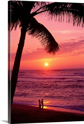 Hawaii, Couple Silhouetted On The Beach At Sunset With Tall Palm Foreground